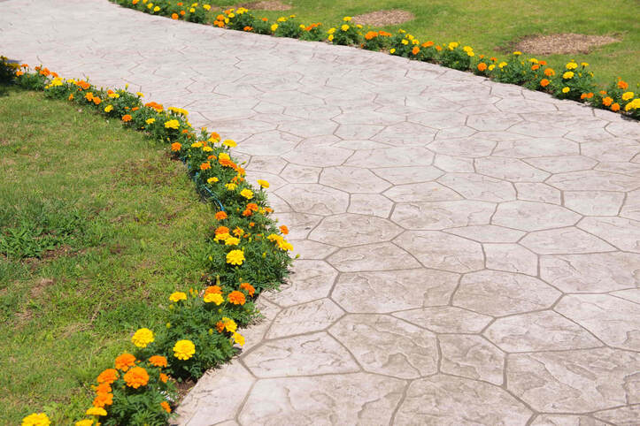 The decorative concrete that was chosen for this pathway was stamped concrete. The design is very elegant yet simple.